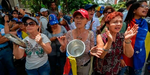 Opposition activists take part in a protest against President Nicolas Maduro's government, in Caracas...