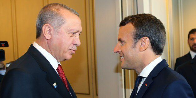 BRUSSELS, BELGIUM - MAY 25: Turkish President Recep Tayyip Erdogan (L) and French President Emmanuel...
