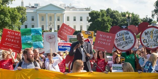 Protesters hold up signs during a demonstration in front of the White House in Washington, DC on June...