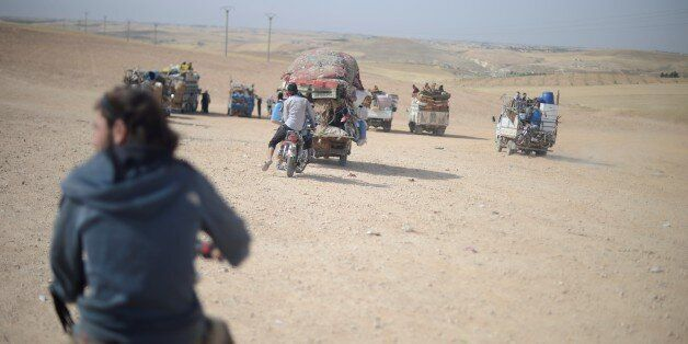 JARABULUS, SYRIA - MAY 26: Civilians, who were forced to migrate after PYD/ PKK terrorist organizations...