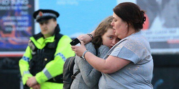 MANCHESTER, UNITED KINGDOM - MAY 23: Walking casualties Vikki Baker and her thirteen year old daughter...