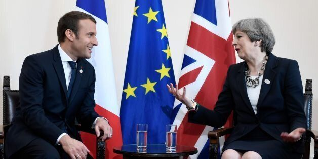 Britain's Prime Minister Theresa May and French President Emmanuel Macron talk during a bilateral meeting...