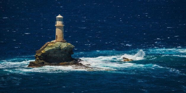 Scenic view to lighthouse near the city of Andros, Andros,