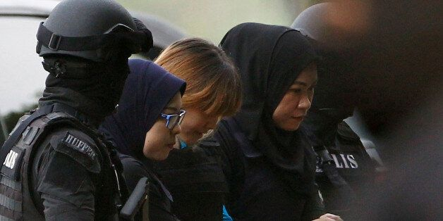 Vietnamese Doan Thi Huong, who is charged for the murder of Kim Jong Nam, is escorted by police as she...