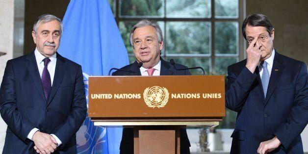 UN Secretary-General Antonio Guterres (C) speaks as Turkish Cypriot leader Mustafa Akinci (L) and Greek...