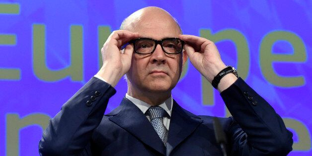 EU Commissioner of Economic and Financial Affairs, Taxation and Customs Pierre Moscovici puts his glasses...