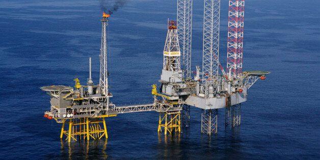 A Santa Fe Galaxy II platform drills a development well at the Thebaud Field natural gas production platform...