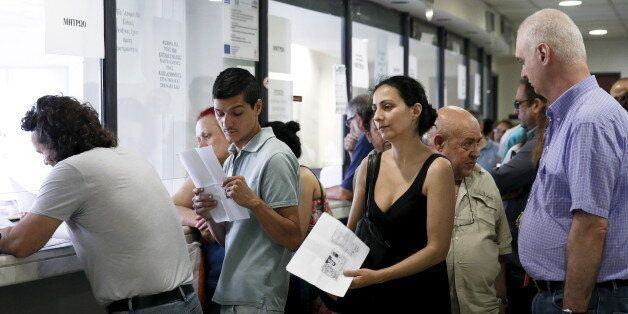 People line up inside a tax office in Athens, Greece, June 25, 2015. Monthly reports by Greece's financial...