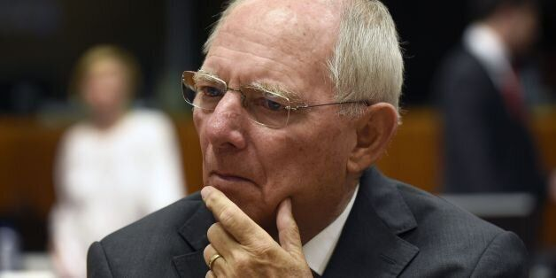German Finance Minister Wolfgang Schauble looks on before a session of the Economic and Financial Affairs,...