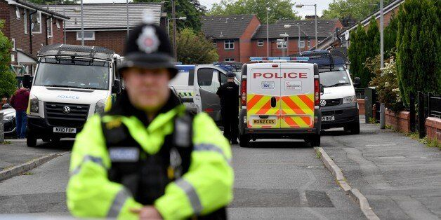 MANCHESTER, ENGLAND - MAY 28: Police close the road leading to Quantock Street in the Moss Side area...