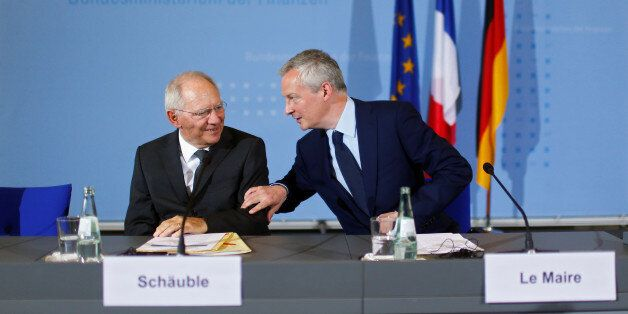 German Finance Minister Wolfgang Schaeuble and French Economy Minister Bruno Le Maire attend a news conference...