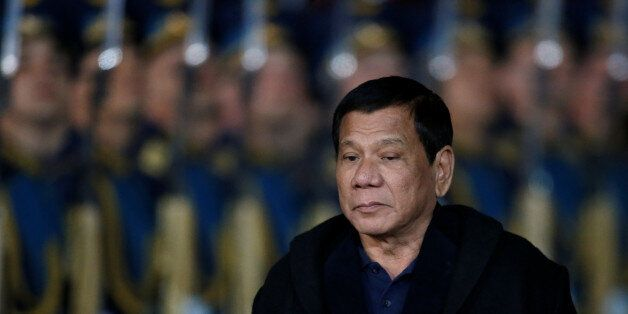 Philippine President Rodrigo Duterte inspects the honour guard during a welcoming ceremony upon his arrival...