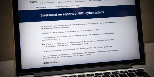 LONDON, ENGLAND - MAY 12: A message informing visitors of a cyber attack is displayed on the NHS website...
