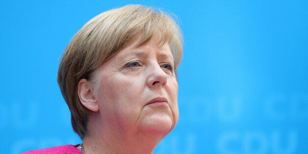 Angela Merkel, Germany's chancellor and leader of the Christian Democratic Union (CDU), looks on during...