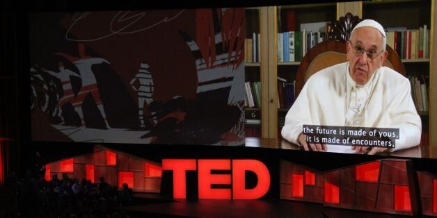 Pope Francis speaks during the TED Conference, urging people to connect with and understand others, during...