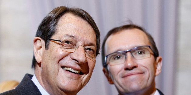 Cypriot President Nicos Anastasiades (L) arrives with U.N. special envoy Espen Barth Eide for the Cyprus...
