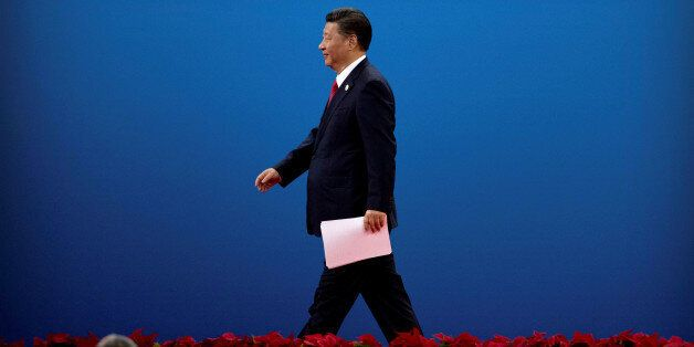 Chinese President Xi Jinping leaves the stage after speaking during the opening ceremony of the Belt...