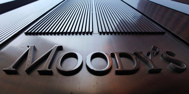 A Moody's sign on the 7 World Trade Center tower is photographed in New York August 2, 2011. Behind all...