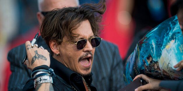 Actor Johnny Depp arrives for the world premiere of Disney movie 'Pirates of the Caribbean: Dead Men...