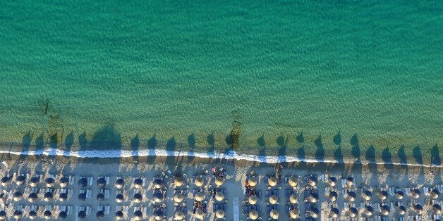 HALKIDIKI, GREECE - JUNE 23: Aerial view of The Pefkochori beach with umbrellas on June 23, 2015 in Halkidiki,...