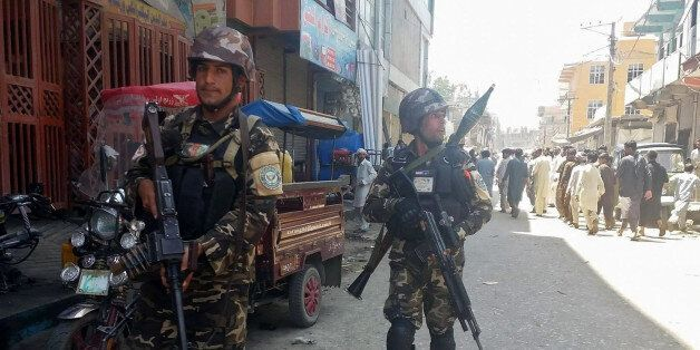 Afghan security forces arrive at the site of an attack in Jalalabad city, eastern Afghanistan May 17,...