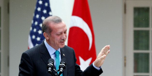 FILE PHOTO - U.S. President Barack Obama (R) and Turkish Prime Minister Recep Tayyip Erdogan hold a joint...