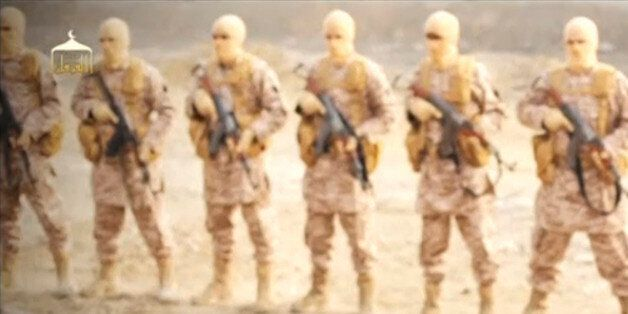 A man purported to be Islamic State captive Jordanian pilot Muath al-Kasaesbeh (in orange jumpsuit) stands...