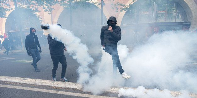 Demonstrators confront police on the annual May Day worker's march on May 1, 2017 in Paris, France. Police...