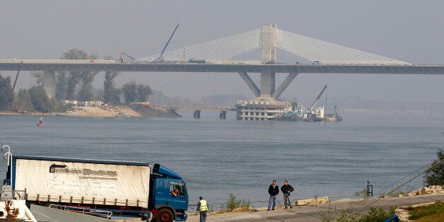 A truck leaves a ferryboat in front of the newly built bridge over Danube that links Calafat in Romania...