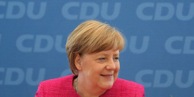 Angela Merkel, Germany's chancellor and leader of the Christian Democratic Union (CDU), reacts during...