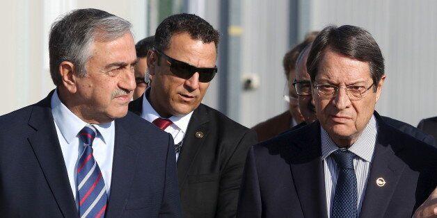 U.N. member of the Committee on Missing Persons (CMP) Paul Henri Arni (R) talks with Greek Cypriot leader...