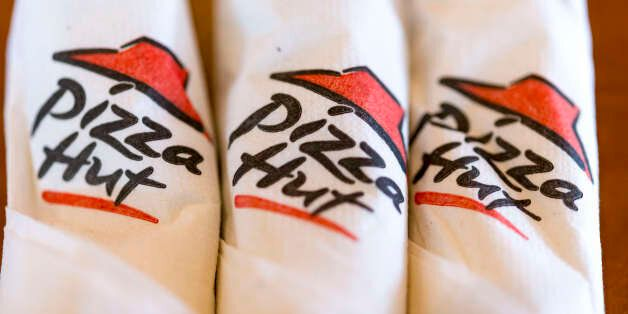 TORONTO, ONTARIO, CANADA - 2016/05/08: Pizza Hut rolled up paper napkin with logo printed on them while...