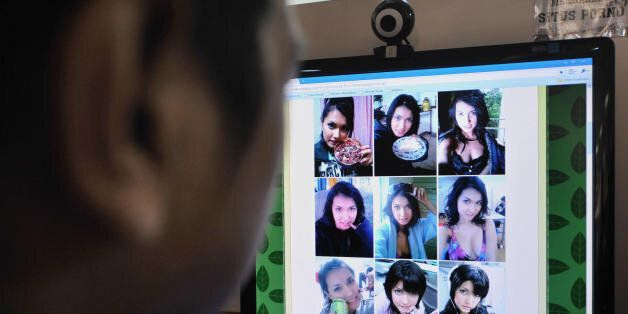 A man browses at pictures of Japanese porn star Maria Ozawa posted on a local website at a public Internet...