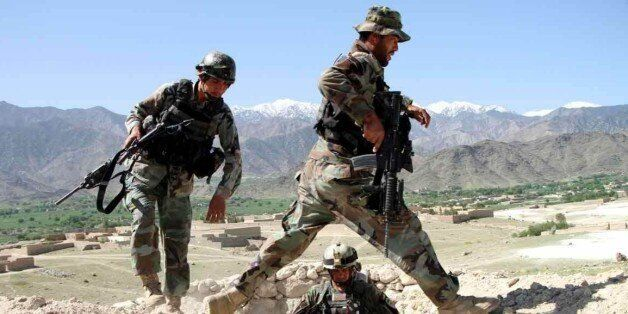NANGARHAR, April 14, 2017 -- Afghan army soldiers walk near a checkpoint, 2 km from the explosion core...