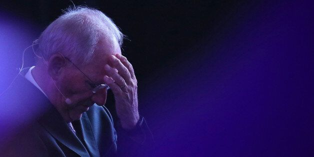 Wolfgang Schaeuble, Germany's finance minister, reacts before speaking during the B20 Summit, a business...