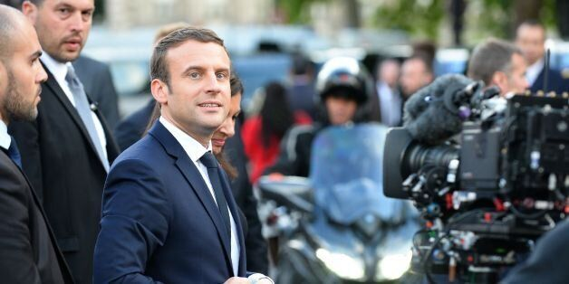 French President Emmanuel Macron leaves the City Hall after an official ceremony with the city mayor...