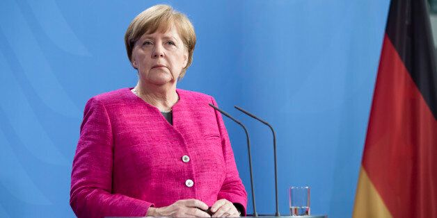 German Chancellor Angela Merkel is pictured during a news conference held with French President Emmanuel...