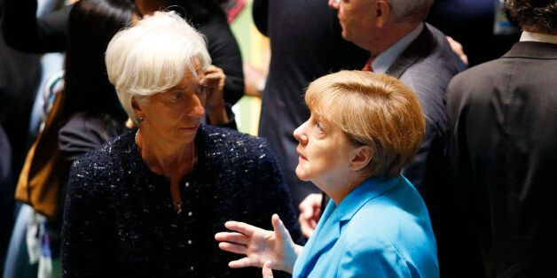 German Chancellor Angela Merkel (R) and IMF head Christine Lagarde arrives for a plenary meeting of the...