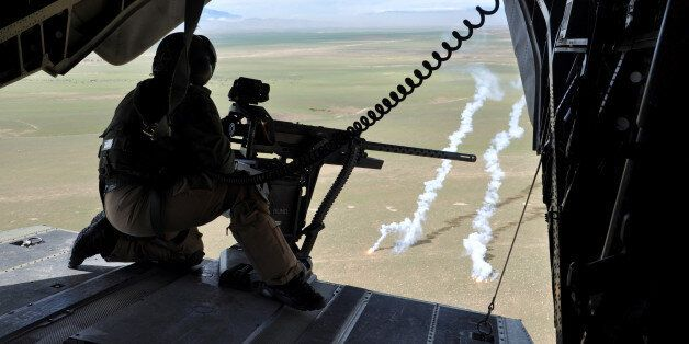 A soldier of the German armed forces Bundeswehr in a CH-53 helicopter on their way from Mazar-i-Sharif...