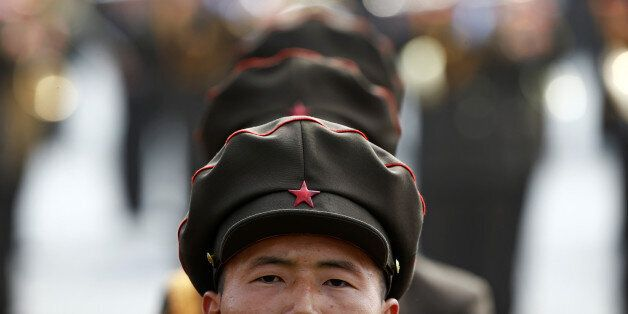 North Korean soldiers attend a military parade marking the 105th birth anniversary of country's founding...