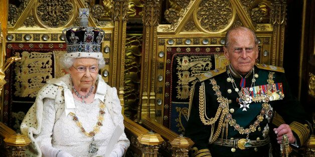 Britain's Queen Elizabeth delivers the Queen's Speech next to Prince Phillip during the State Opening...