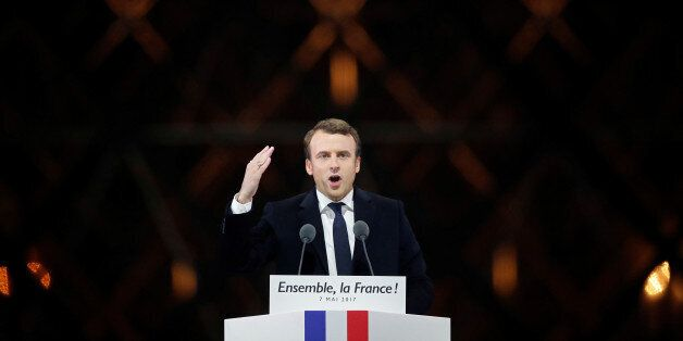 French President-elect Emmanuel Macron celebrates on the stage May 7, 2017 at his victory rally near...
