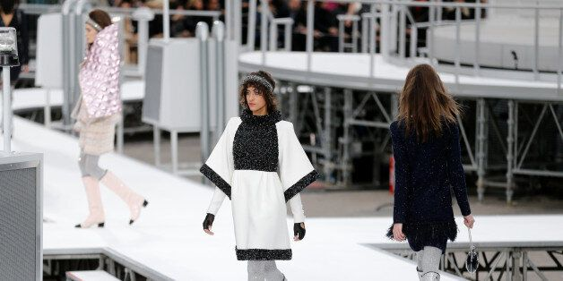 Models present creations by German designer Karl Lagerfeld as part of his Fall/Winter 2017-2018 women's...