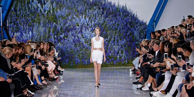 Model Sofia Mechetner presents a creation by Belgian designer Raf Simons as part of his Spring/Summer...