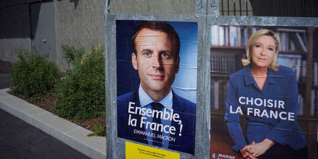 New official posters for the candidates for the 2017 French presidential election, Emmanuel Macron (L),...