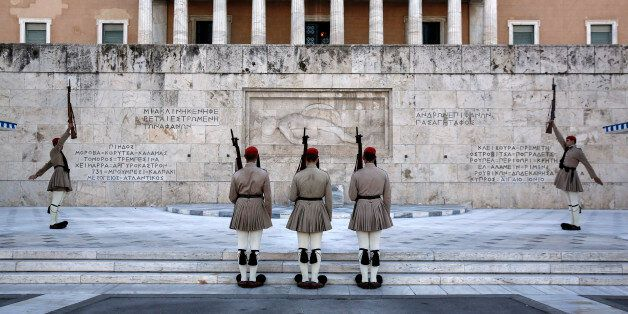 Presidential guards perform ceremonial duties at the Tomb of the Unknown Soldier outside the Greek parliament...