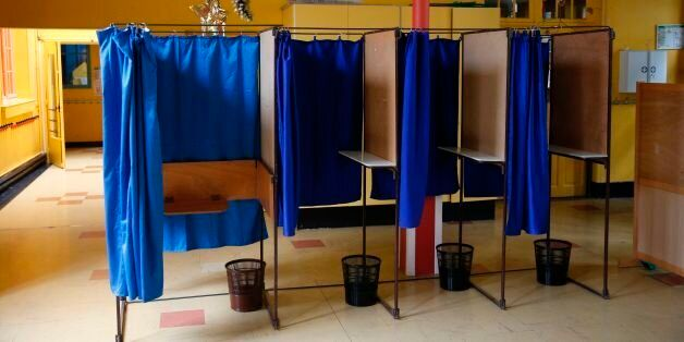 A photo shows voting booths at a polling station in a nursery school in Montreuil, outside Paris, on...