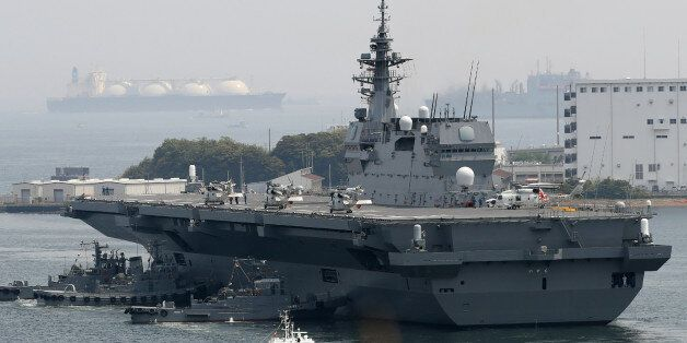 Japan's Maritime Self Defense Forces helicopter carrier Izumo sails out its Yokosuka Base in Kanagawa...