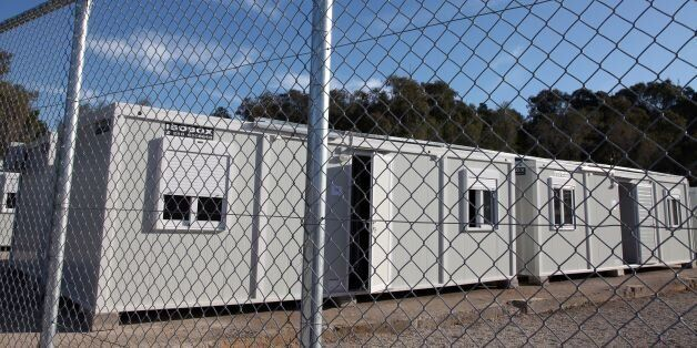A picture shows prefabricated houses in a registration centre for migrants and refugees on the Greek...