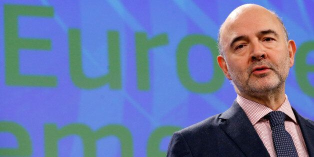 European Economic and Financial Affairs Commissioner Pierre Moscovici addresses a news conference on...